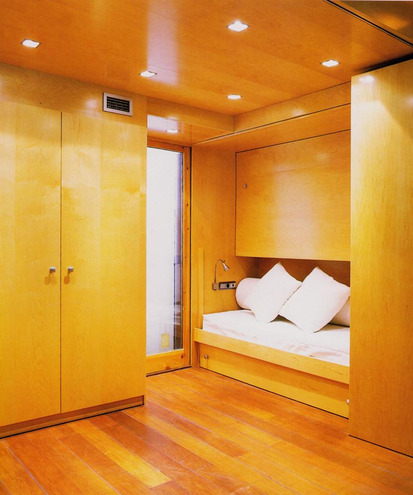 Dormitorio en madera de fresno
